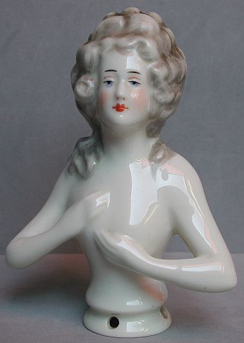 Magnificent large nude half doll with hands on her chest