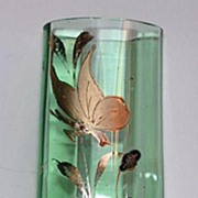 Cute little art nouveau vase with golden flower and butterfly