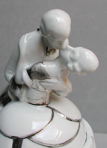 Ooh! Passionate kissing couple powder jar/half doll rel.