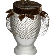 Pill Box Hat with Netting and Velvet Bows