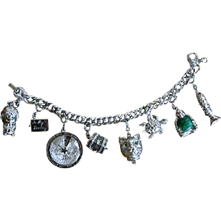 Vintage MONET Mechanical Silvertone Charm Bracelet with 8 Adorable Charms