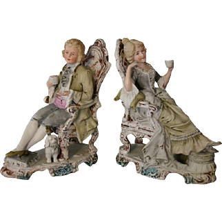 Wonderful Pair of Victorian Era German Bisque Figurines with Man and Woman Taking Tea with Spaniel Dog