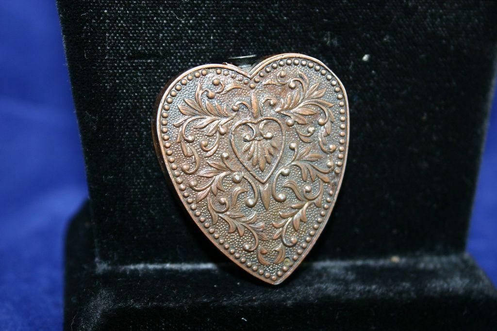 vintage novelty repousse heart shaped lighter from dejavuantiques on ruby lane