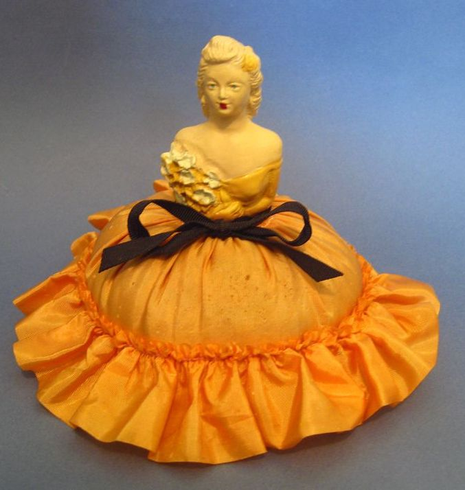 Vintage Lady Pin Cushion In Peach Colored Skirt and Ruffle