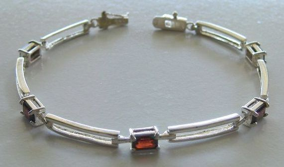 Lovely and Elegant Prong Set Garnet and Sterling Silver Link Bracelet