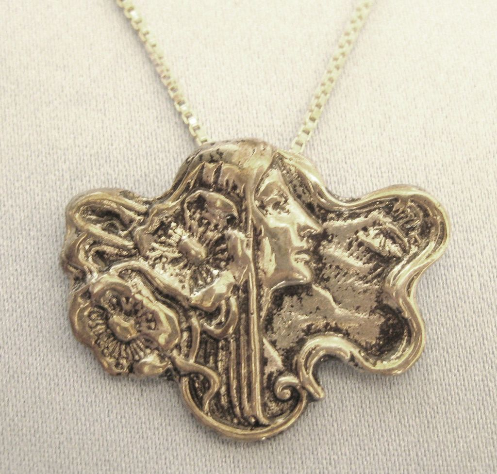 lovely sterling silver profile with flowers pendant