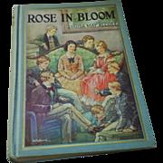 Rose in Bloom, Alcott