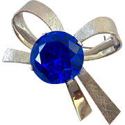 Heavy 10K White Gold 20.0 Grams Blue Spinel 23-25 Estimated Carat Weight Bow Brooch or Pendant