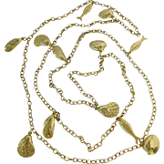 Long Gold Tone Necklace with Beach Seashore Dangles Shells Fish
