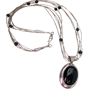 Sterling Liquid Silver Five Strand Necklace with Onyx Stations and Pendant