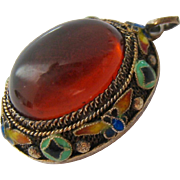 Amber, Enamel and Gilt Silver Cannetille Pendant