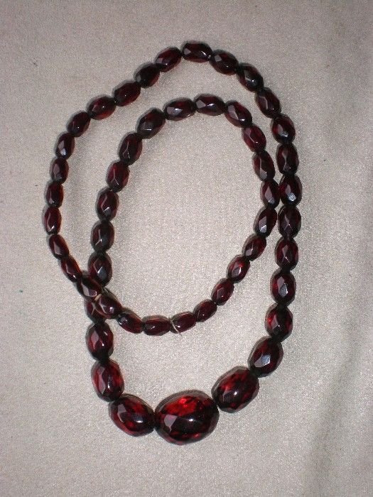 "Beautiful 20"" Strand of Faceted Cherry Amber Beads"