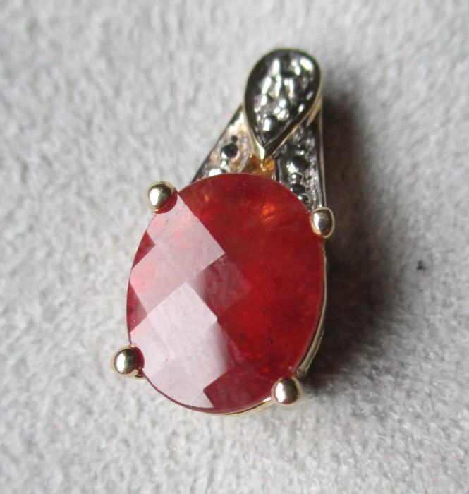 beautiful 14k gold and hessonite garnet pendant from