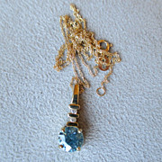 Beautiful 10k Gold Blue Zircon Pendant with Diamond Accents