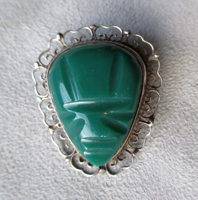 Carved mexican pin pendant with green stone from