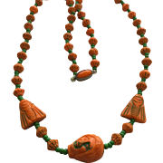 Vintage Czech Egyptian Revival Face Bead, Orange and Green, Necklace