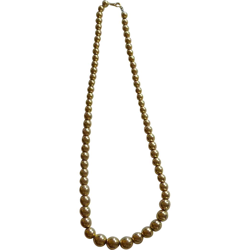 Graduated Gold Tone Bead Necklace