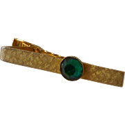 Gold Tone with Green Facet Glass Tie Bar