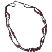 Black Two Strand Iridescent and Ruby Red Glass Bead Necklace