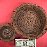 Two vintage mid 1900s (or older) coiled pine needle baskets from the South or SE United States