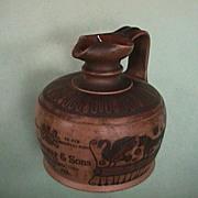 c1902 Royal Doulton stoneware jug with Corinthian Black Figures made for John Dewar & Sons