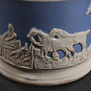 c1830 Late transitional Creamware blue ground Child's Mug with white sprigged Hunting Scene