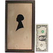 c1900 Cut Paper Silhouette of Woman wearing Spectacles (signed and framed under glass)