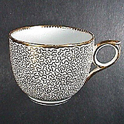 c1815 English Hand Decorated Porcelain Teacup with a Vermiculate overglaze Gold Motif