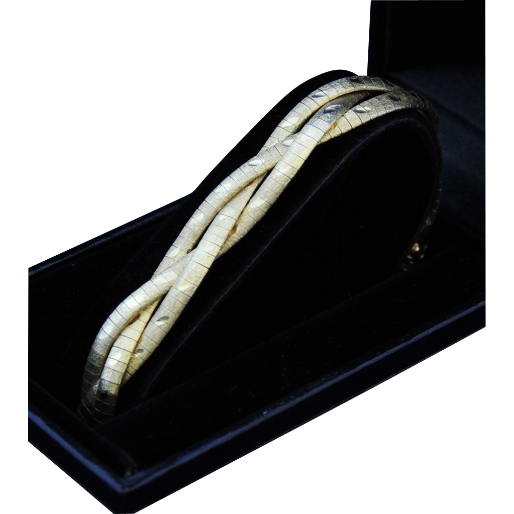 SUNNING VINTAGE,  Braids of 14kt Yellow Gold