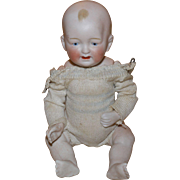 Antique German all bisque baby 7 inches