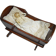 Old Wooden Cradle with Wax Baby