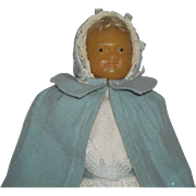 Wax Faced Mystery Doll