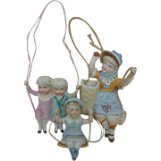Lot of Three Antique Bisque Figurines on Swings German