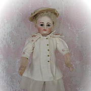 Fabulous Early Block Letter FG Bebe Circa 1870s with Skin Wig and Original Early 8 Ball Body