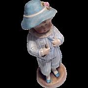 German Bisque Boy Holding Fish Doll Figurine