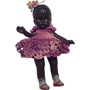 Adorable All Bisque Black African American Girl Doll with Purple Crochet dress