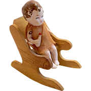 German All Bisque Doll Holding Bottle on Wood Chair Dollhouse Miniature