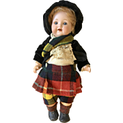 AM 990 Bisque Character Toddler Dressed as Scottish