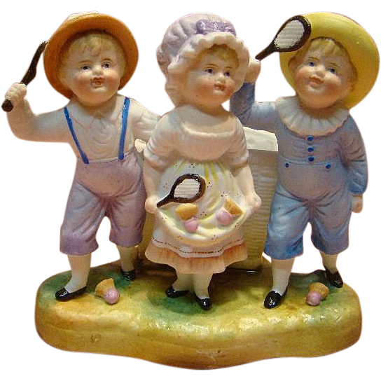 Antique Porcelain Figurine of Three Children Playing Badminton