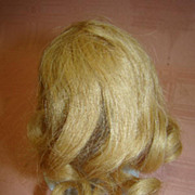 4.5 In. Cir. French Human Hair Long Blond Curls Wig