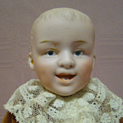10.5 In. Laughing Character Heubach Boy, Open/Closed Mouth, Two lower Teeth, Intaglio Eyes