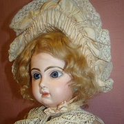 22 In. Sz 10 French Closed Mouth Tete Jumeau, Fully Marked Head and Body, Blue Paperweight Eyes, Flawless Bisque, Beautifully Dressed