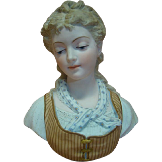 Breathtaking Piece of Art in a 12 In. Porcelain Bust of a Young Lady with Downcast Eyes, Extremely Modeled Hair