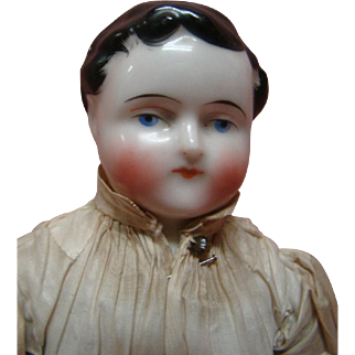 13 In. Original Male China Shoulder Head with Molded Curls, Stippling and Exposed Ears, Cloth Body with Leather Arms, Stitched Fingers