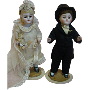 """3-3/4"""" Original German All Bisque """"Bride and Groom,"""" Glass Eyes, Closed Mouths, Wigged, Early Wire Joints at Shoulders and Hips"""