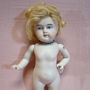 6-1/4 In. German Early Style All Bisque with Heeled Bootines and Wrestler Style Body, Clenched Fist, Painted Eyes, Closed Mouth, Mohair Wig