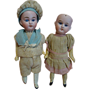 8 In. Original Pair of German Bisque Head Dolls on Paper Mache 5-Pc. Bodies by Gebruder Knock, cir: 1887-1918, Boy Mold #193 and Girl Mold #201