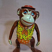 Cute Made in Japan Inakite Wind-Up Monkey with Colorful Painted Outfit and Red Hat, Big Ears, Steps and Sways Side to Side.
