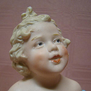 """9-3/4 In. Antique All Bisque Figurine by Gebruder Heubach, Germany, Known as the """"Young Character Girl in Wicker Chair"""""""