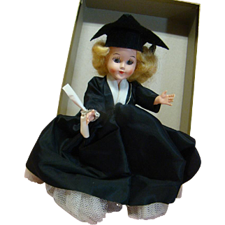 7.5 In. Hard Plastic Doll in Complete Graduation Attire, Holding Diploma, Sleep Eyes, Soft Blond Wig, Jointed at Neck and Shoulders